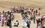 Profughi siriani in fuga attraverso il Libano