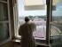 Papa Francesco si affaccia dalla finestra del suo studio, per la recita dell'Angelus
